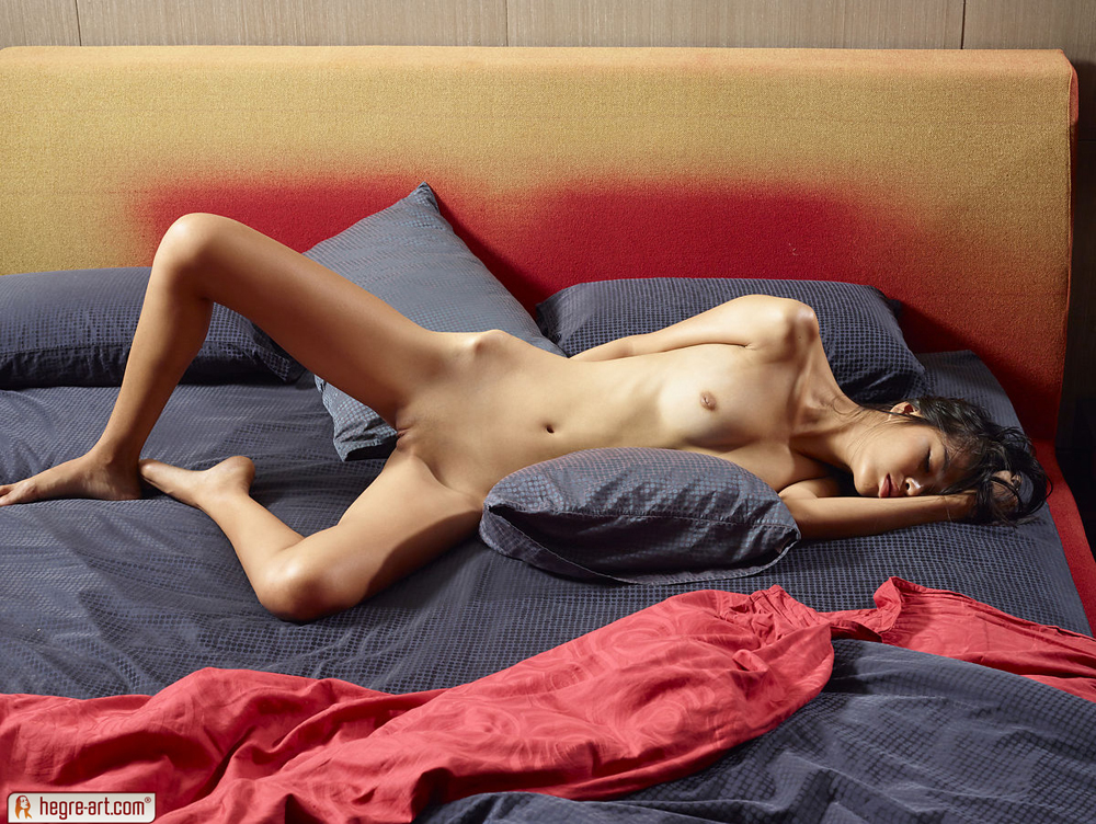 skinny girl bent over bed