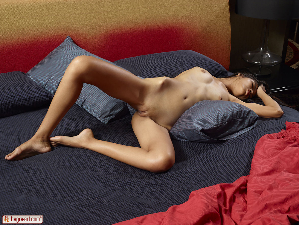 very skinny woman from thailand naked on bed