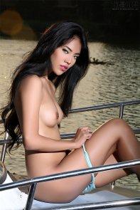 posing nude on boat