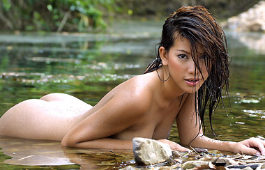 Nude Thai lady bathing in lake