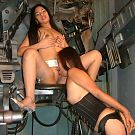 Two horny Asian lesbians lick each others pussies in strange chair