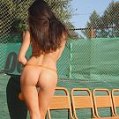 Exotic Aurika goes out to the tennis court and plays with her oranges and puffy nipples.