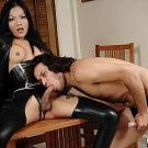 Pattaya transsexual receives head from a submissive ladyboy lover in black leather