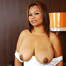 Horny Thai milf shows what she's been hiding under her skimpy dress