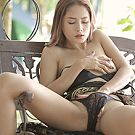 Bangkok milf pushes her hand inside her panties to rub her clitoris.