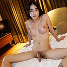 Petite and upper enhanced Sukhumvit LB exposes her ladyboy cock after steamy sex.